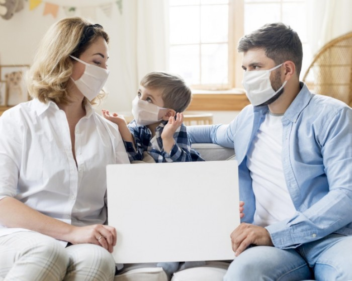 family wearing medical masks indoors copy space 23 2148574013