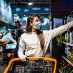 woman with surgical mask gloves is shopping supermarket after coronavirus pandemic girl with surgical mask is going buy some food